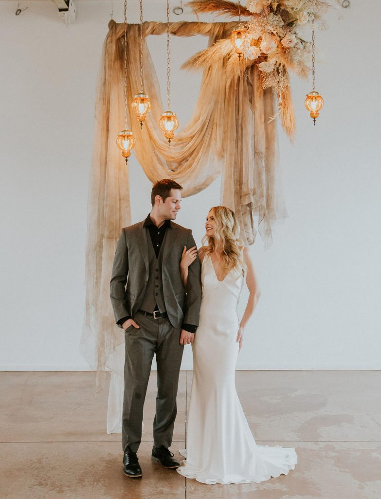 neutral tone hanging fabric modern indoor wedding backdrop