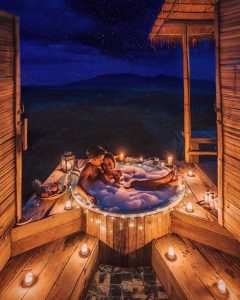 romantice honeymoon photos with candle and light at hotel bath pool
