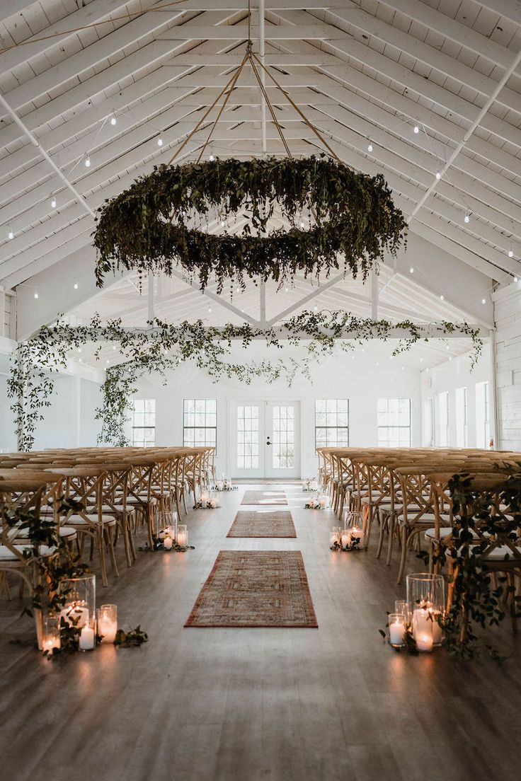 simple greenery winter wedding ceremony decor