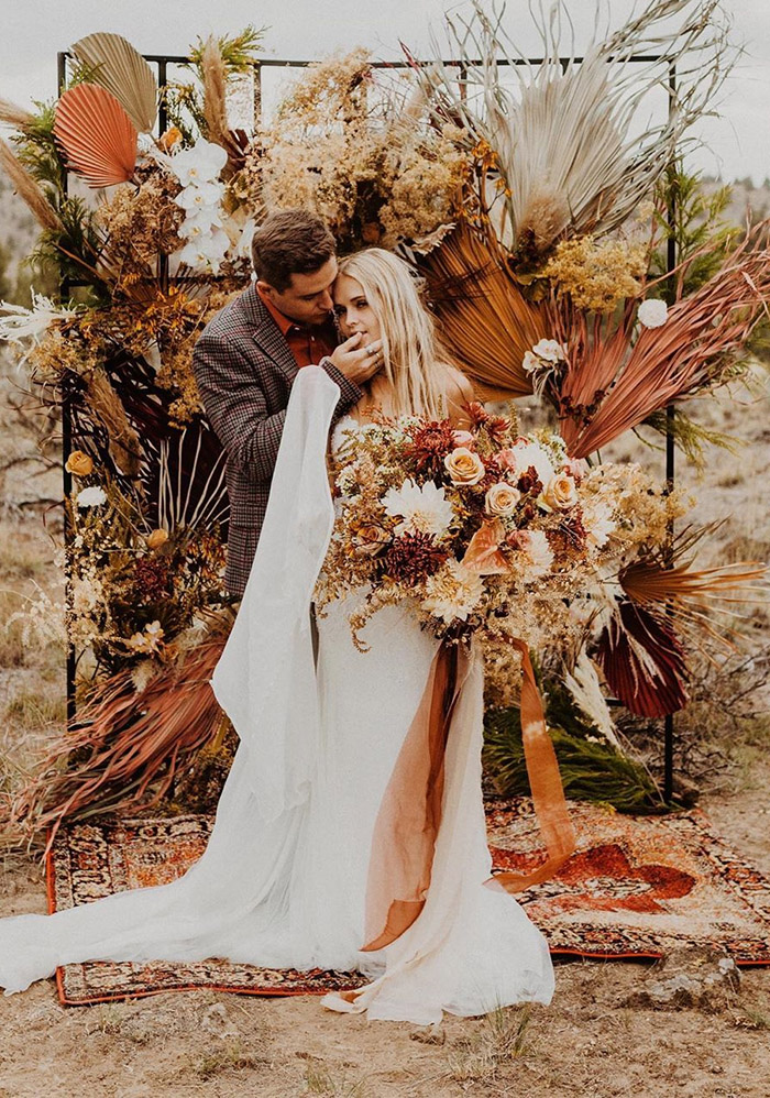 special rust color palms and dry flowers elopement boho wedding arches