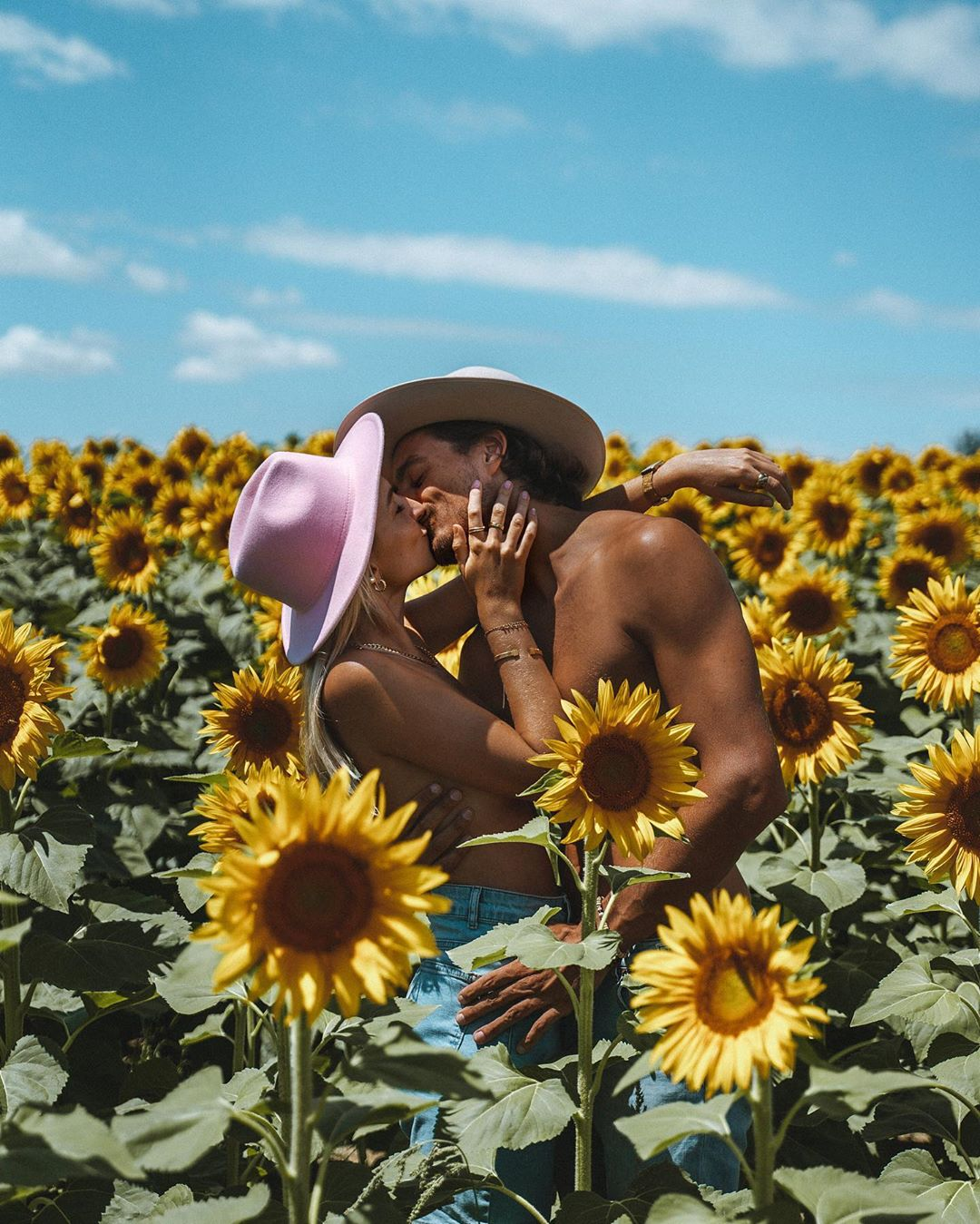 sweet travel coulple kiss at the sunflower field