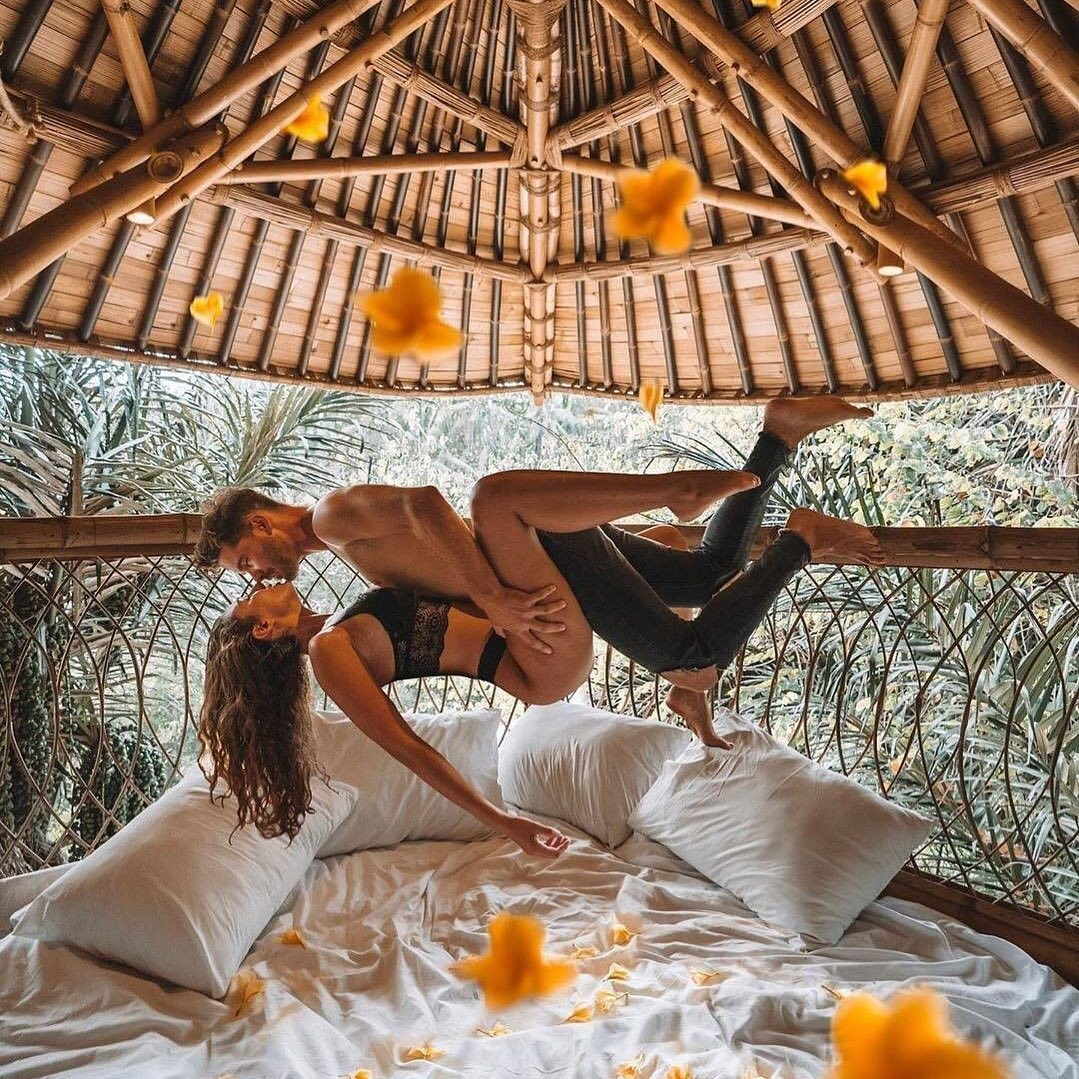 sweetest honeymoon kiss with creative gesture at hotel