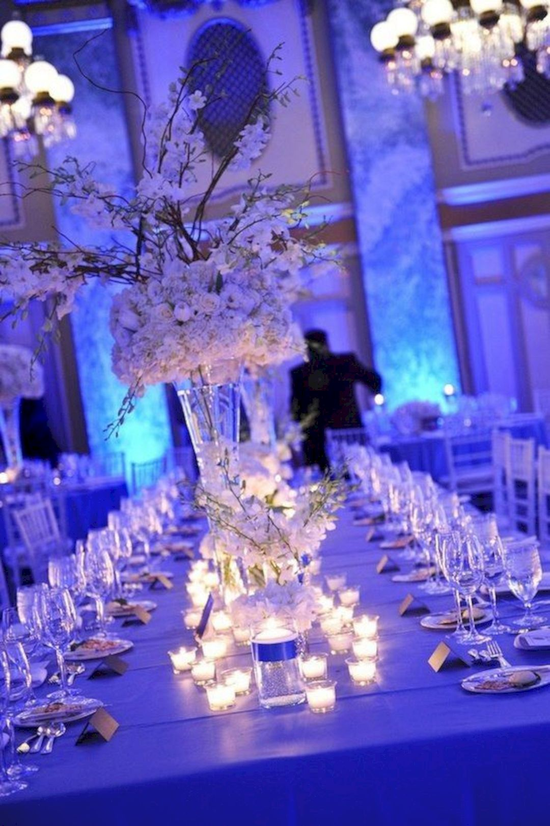 tall white flower winter wedding centerpieces with blue lighting