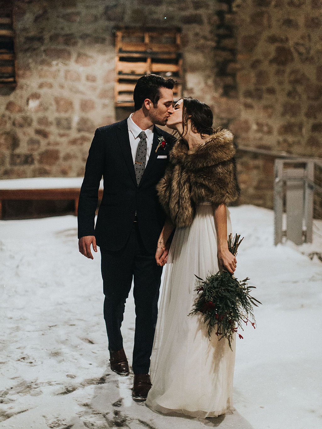 the perfect winter wedding gown with furs to keep bride warm