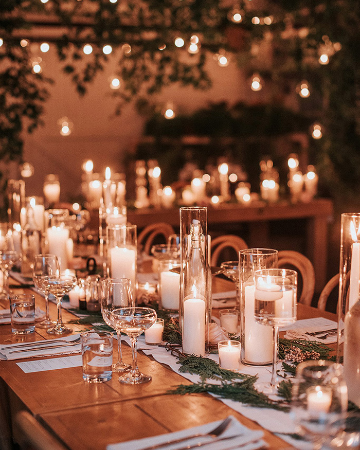 warm candlelit winter greenhouse wedding centerpieces