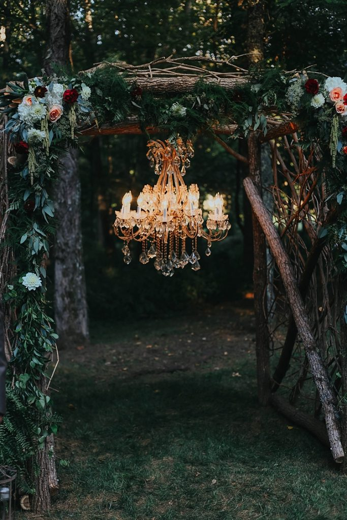 whimsical bohemian wedding altar with crystal chandelier