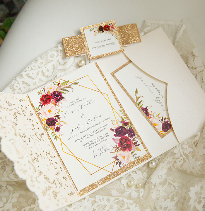 classic ivory pocket laser cut wedding invitation with blush and burgundy flowers design
