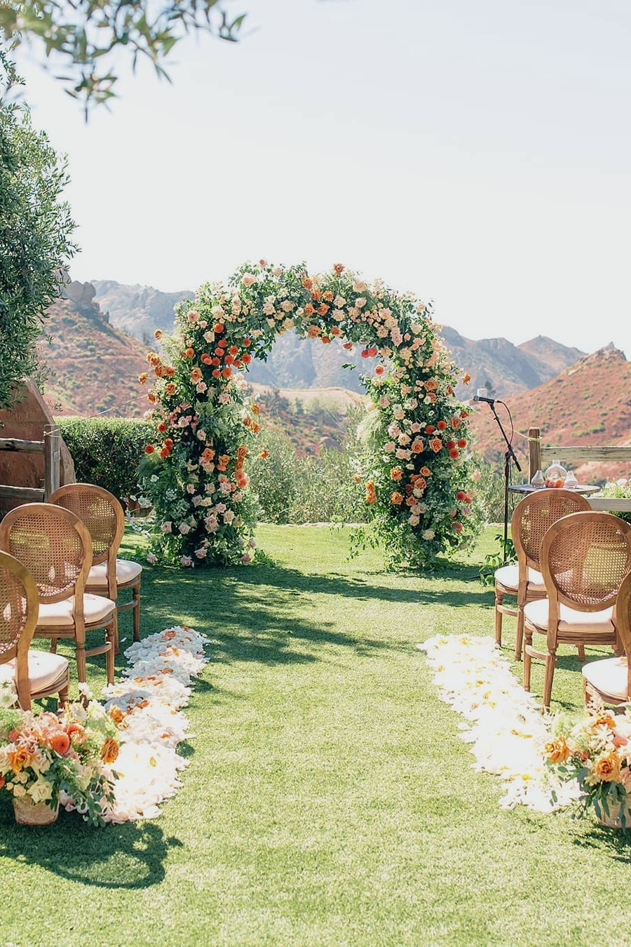 coral and white floral decoration ideas for small outdoor wedding arches 1