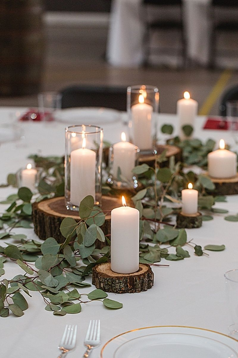 diy wood slice and green garland wedding centerpieces with candles