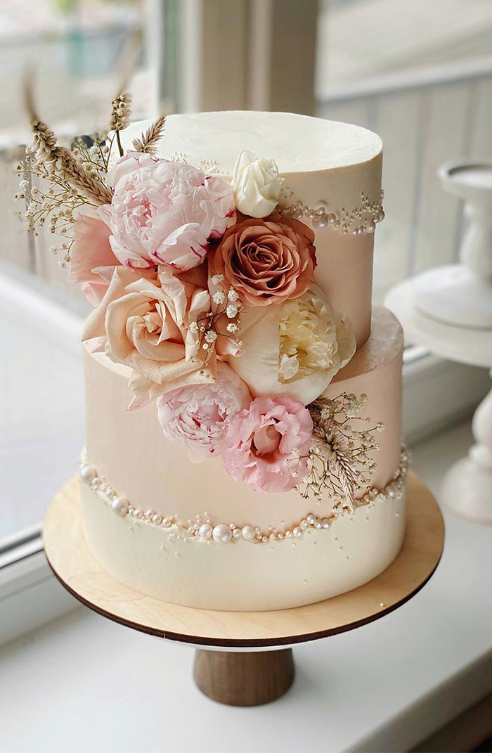 elegant flowers spring and summer wedding cake with pearls