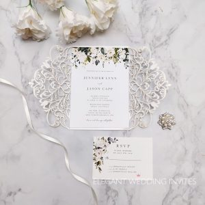 elegnat ivory and white flowers and greenery pattern laser cut invitation