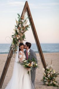 gergous triangle arbor with dried flowers for the micro wedding ideas