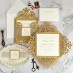 gold laser cut wedding invitation with luxurious glitter and mirror tag EWWS297