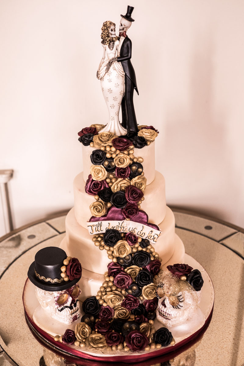 gothic wedding cake with skull bride and groom cake topper