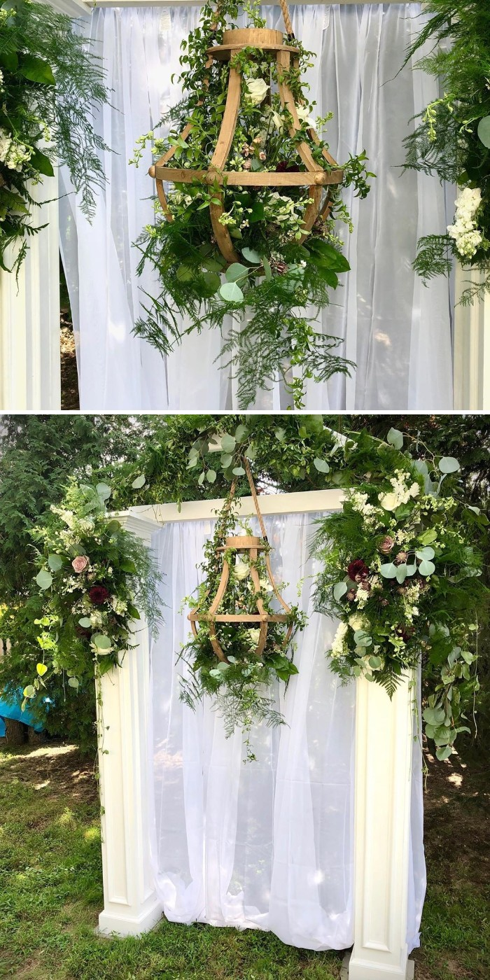 greenry wedding arbor with white fabric for backyard wedding ideas