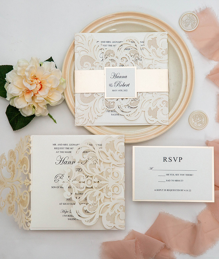 ivory and champane shimmer laser cut wedding invitations
