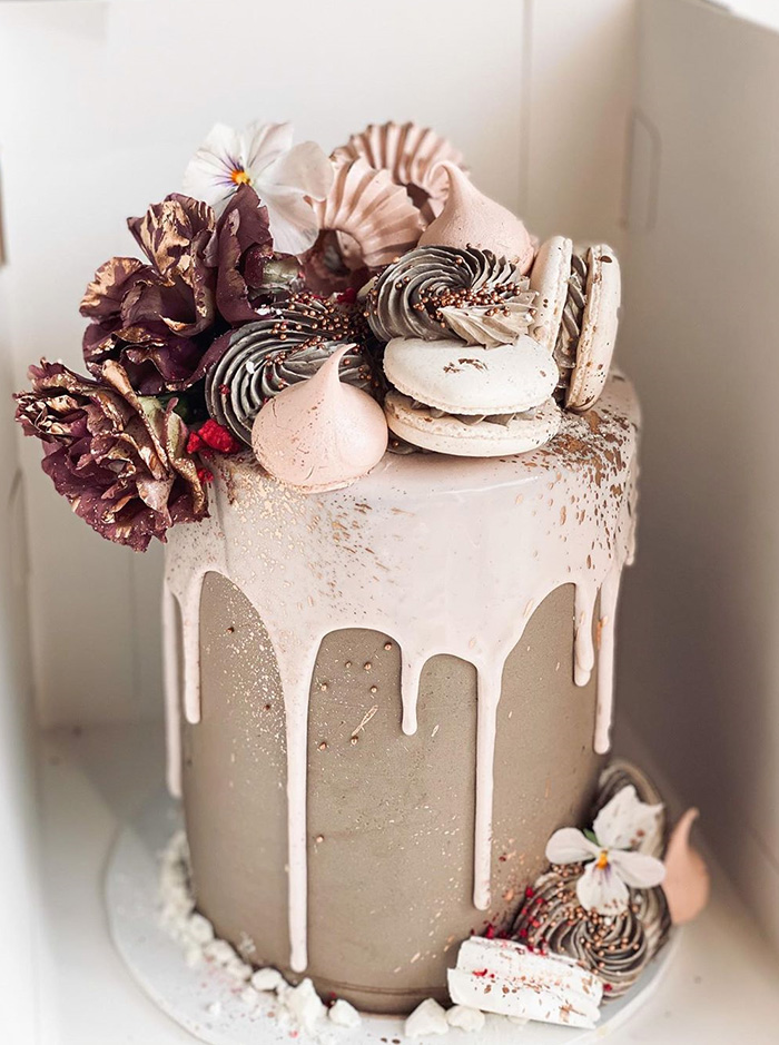 mini flower and macaron decotaed dripping wedding cake