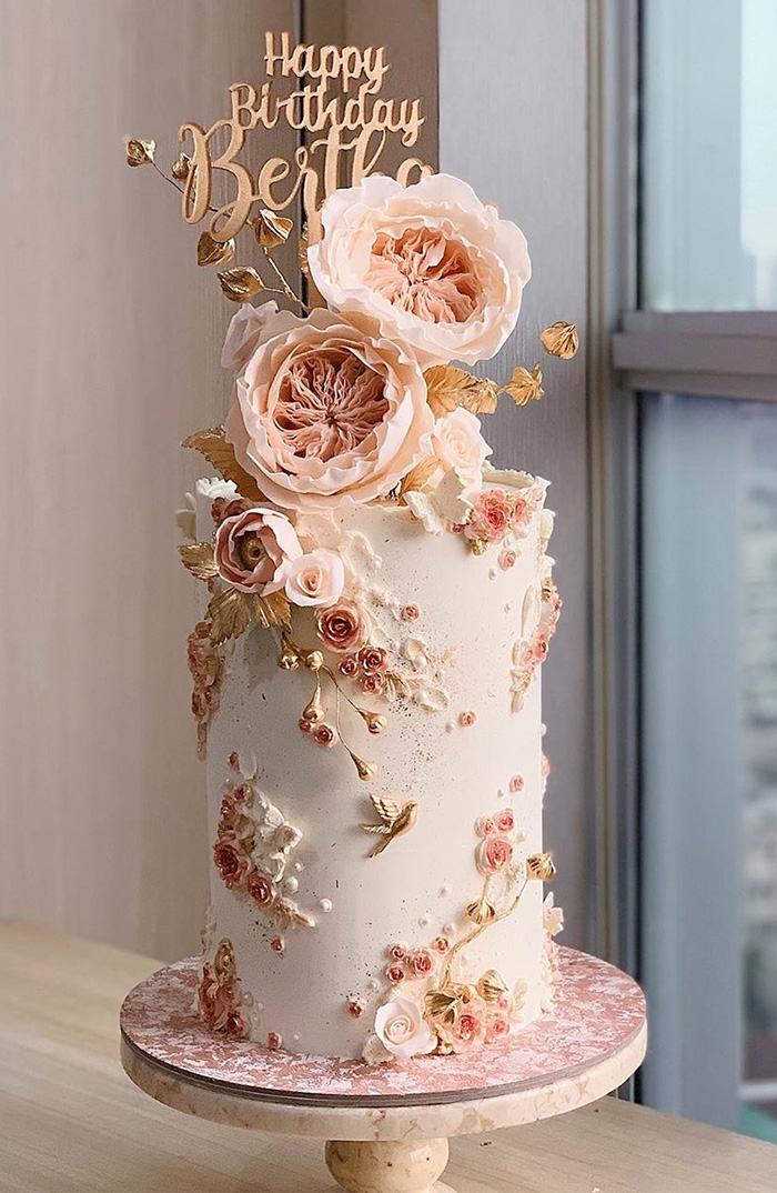 pink floral paniting on skiny wedding cakes