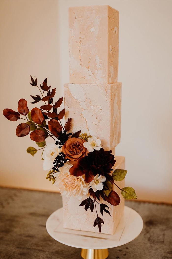 square tiered wedding cake with fall flowers