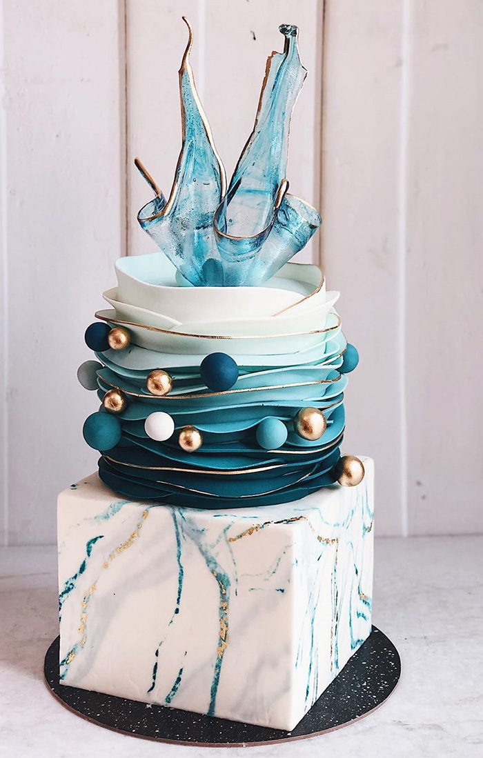 teal blue gold ball modern wedding cake with unique isomalt cake topper