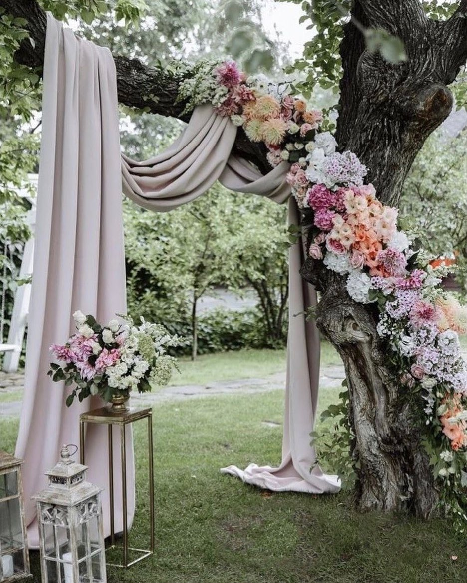 unique wedding arch ideas with georgette hanging on tree for outdoor wedding ideas