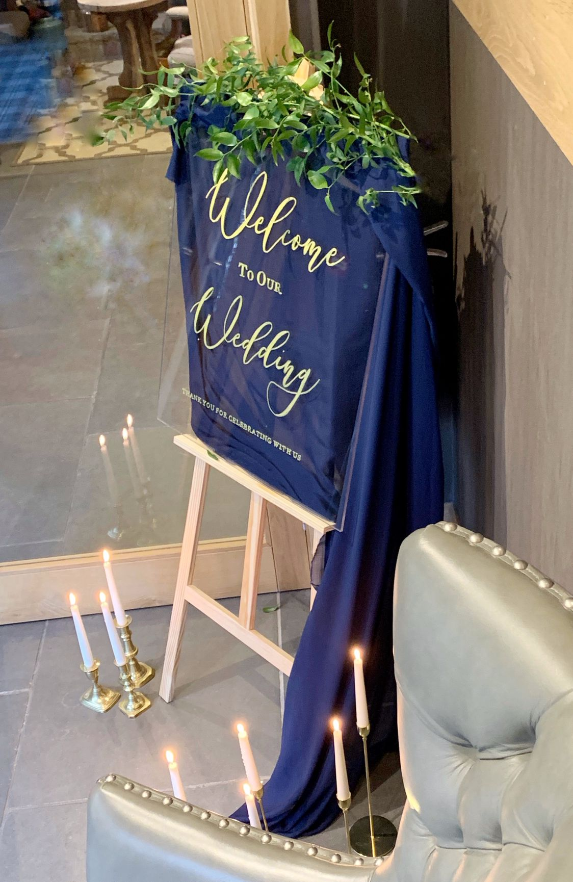 acrylic welcome to our wedding sign with classic blue fabric candles