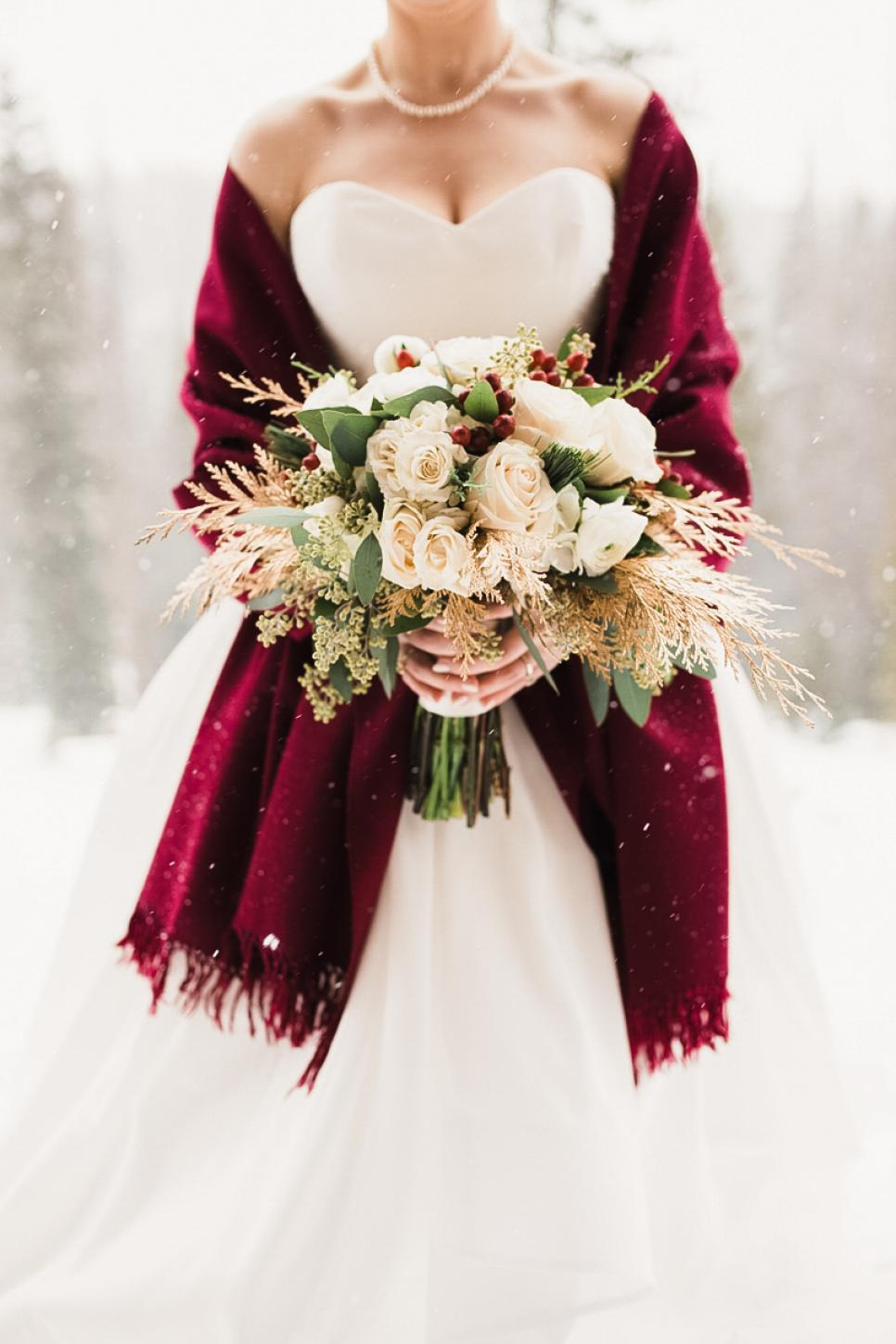 beautiful winter bride photo with flower bouquets