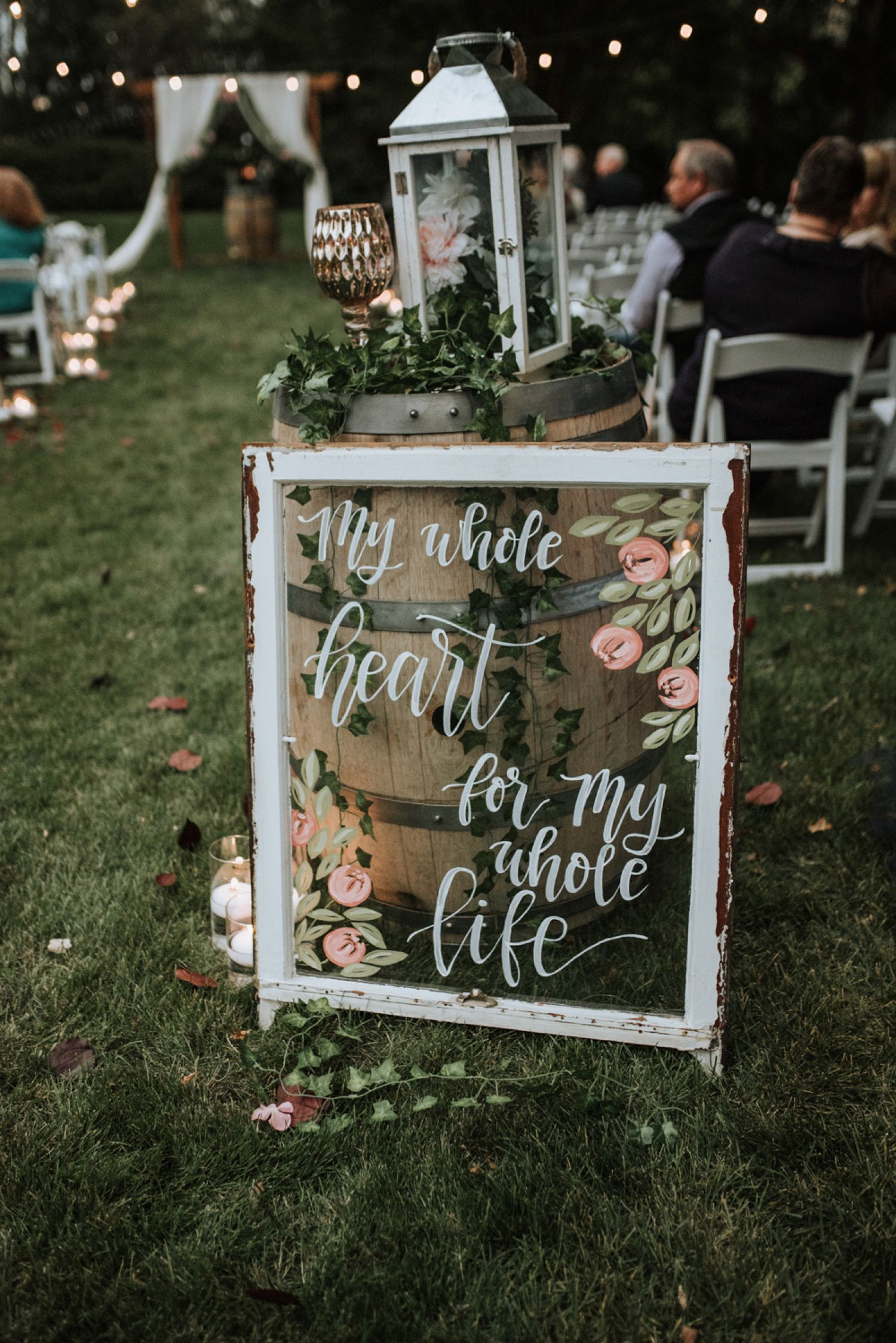 boho style outdoor glass wedding ceremony signs