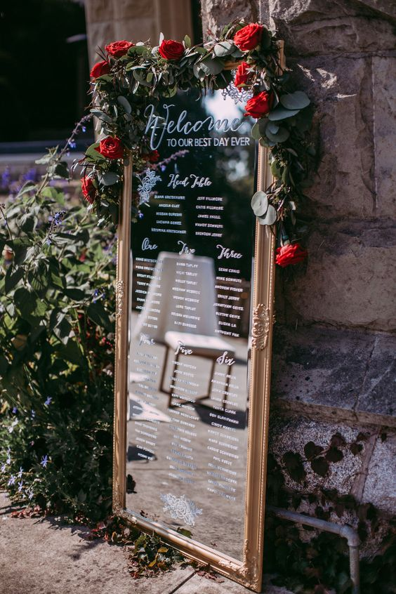 glamorous red rose decorated christmas wedding mirror sign
