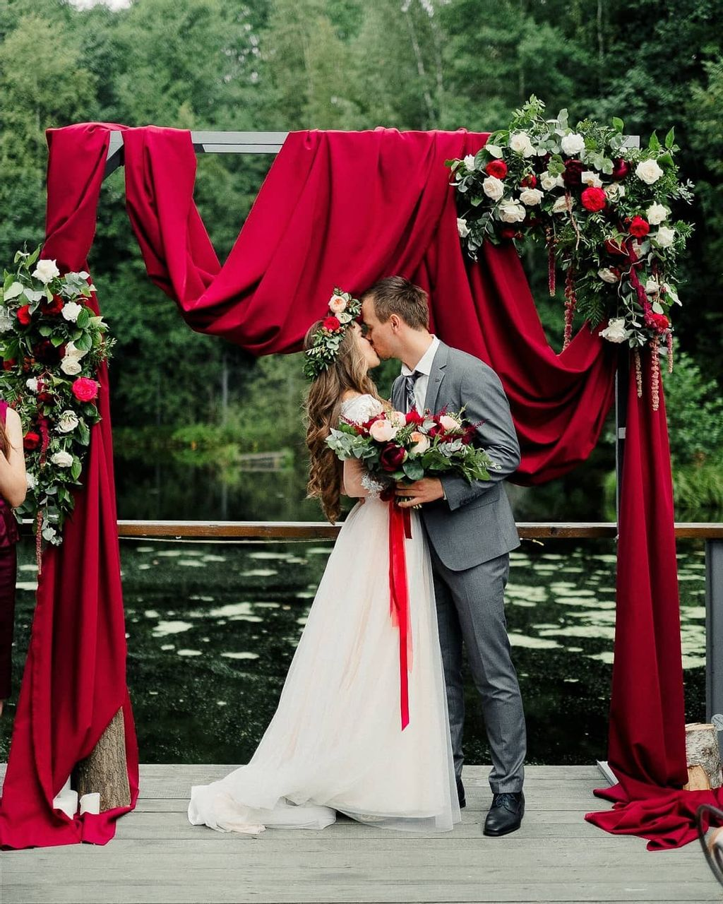 red draped wedding arches for a christmas theme
