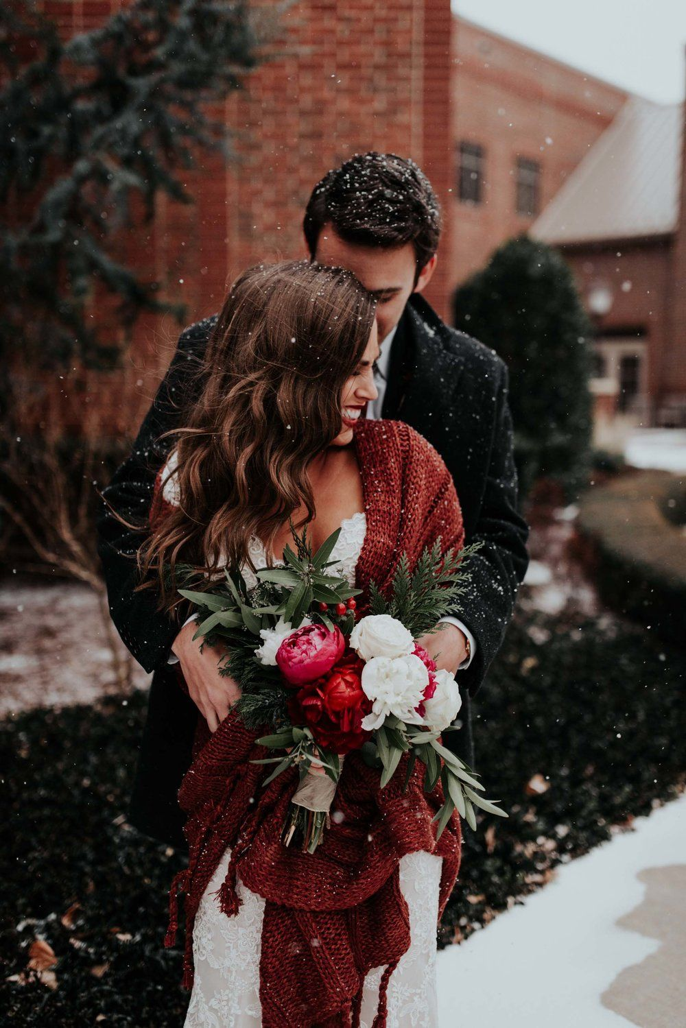 romantic couples wedding photo taken in a snowy day