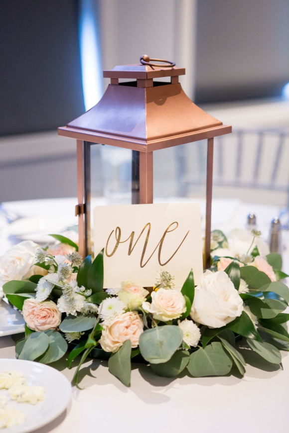 romantic flowers flower and candle in rose gold lantern wedding centerpieces ideas