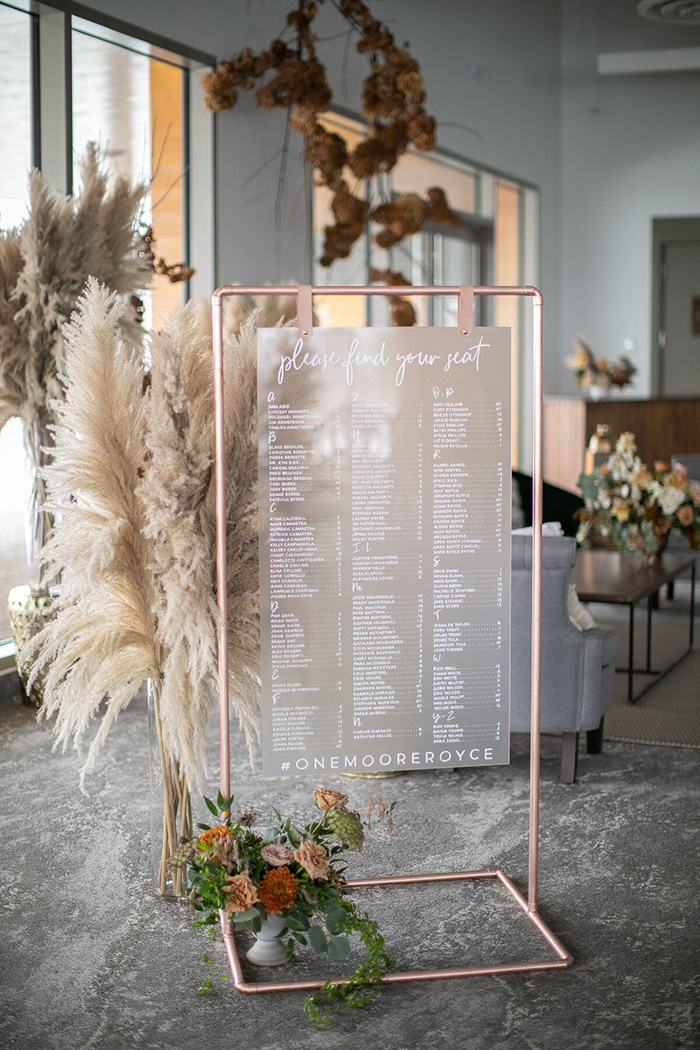 rose gold stand seating chart wedding reception signs with pampass grass