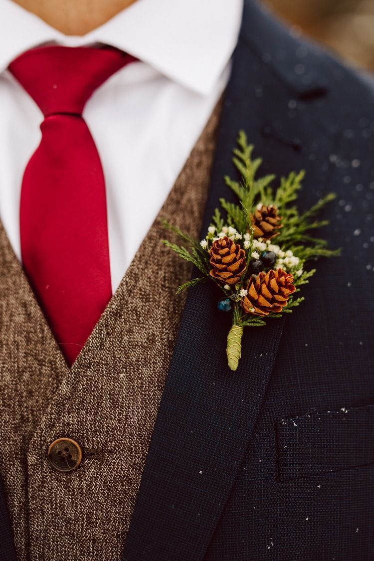 rustic pine cone groom boutonniere
