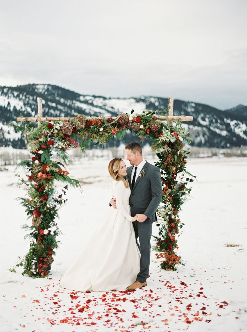 snowy outdoor chrismats wedding ceremony arch