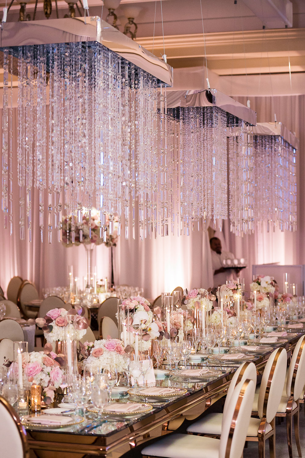 suspended rose gold wedding mirror table decorarions with flowers and candles 1