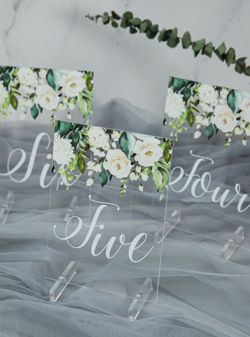 white and sage floral pattern acrylic wedding table signs