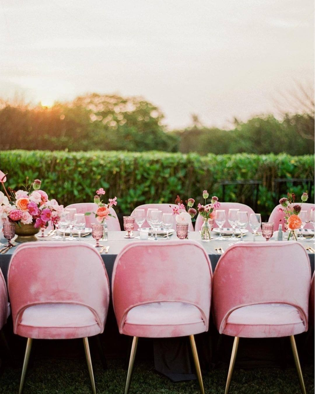 Bold pink colored wedding reception chairs