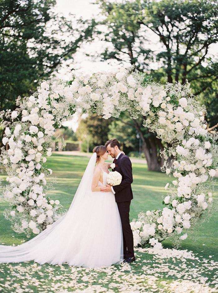 classic white flowers and babys breath garden wedding altars