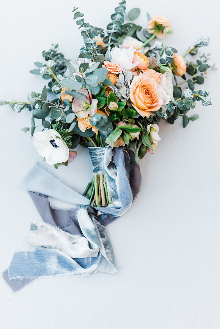 orang flower and greenery wedding bouquets with ribbons