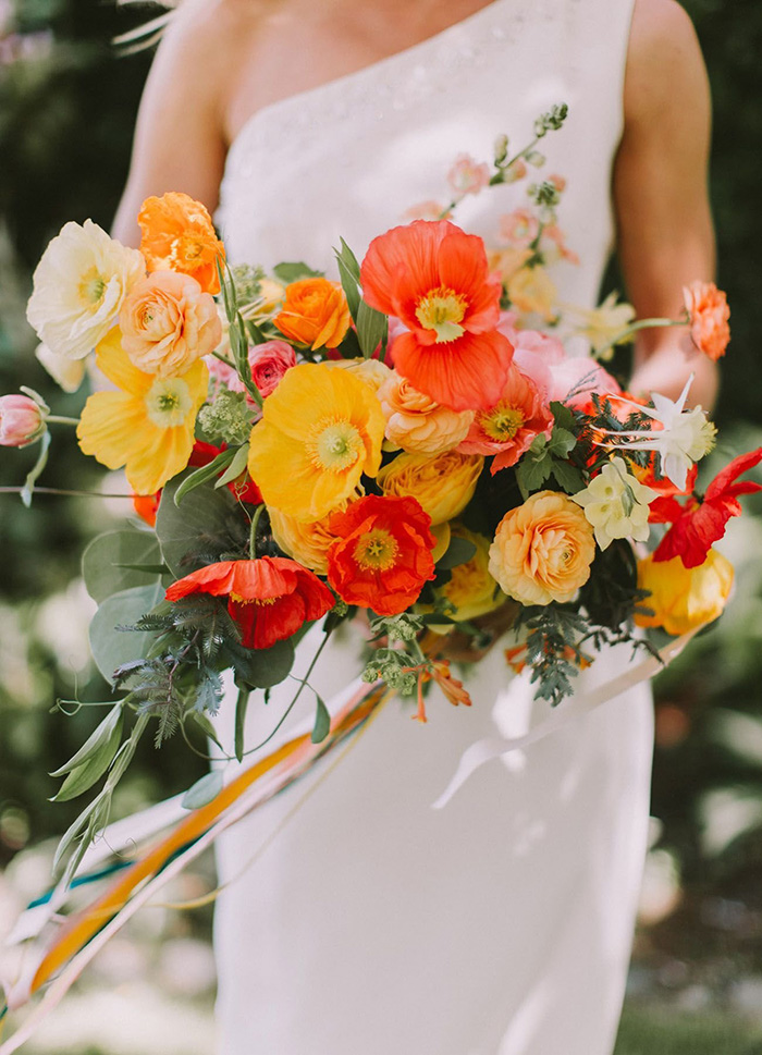 red coral and yellow summer wedding flower bouquets