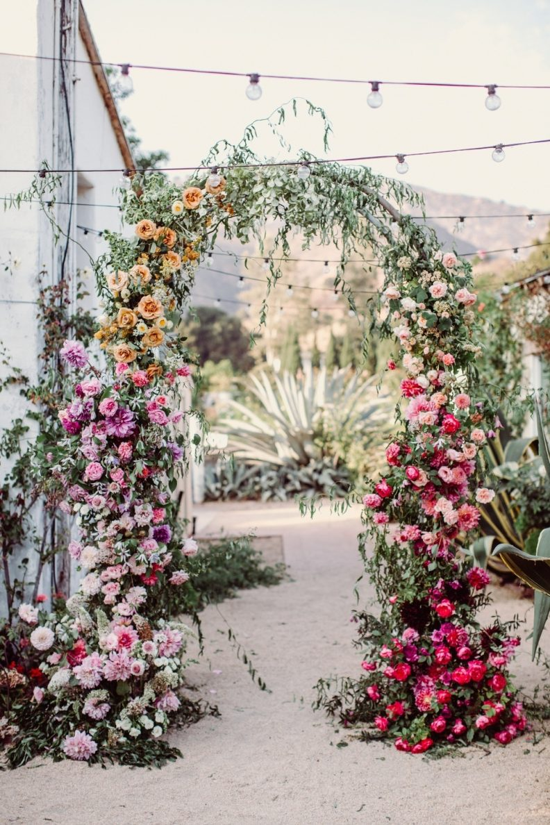 stunning colorful floral weding arch for micro garden wedding