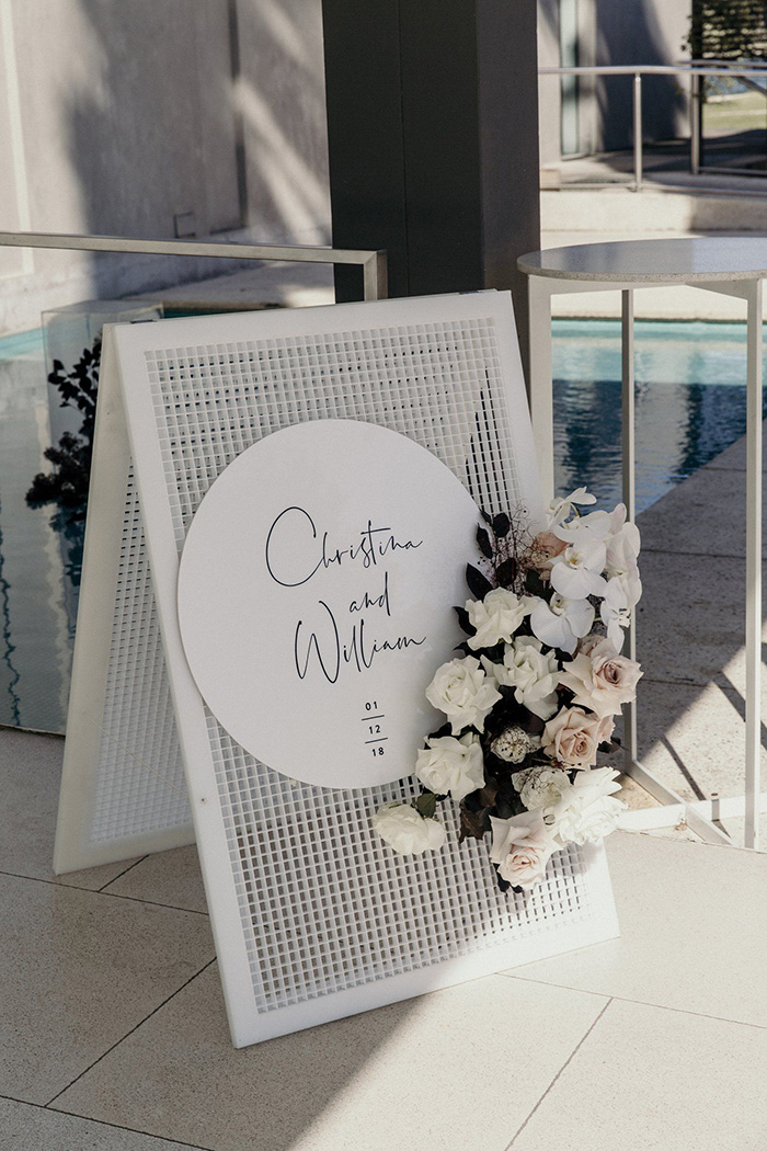 unique white mesh modern wedding sign with dusty pink flowers
