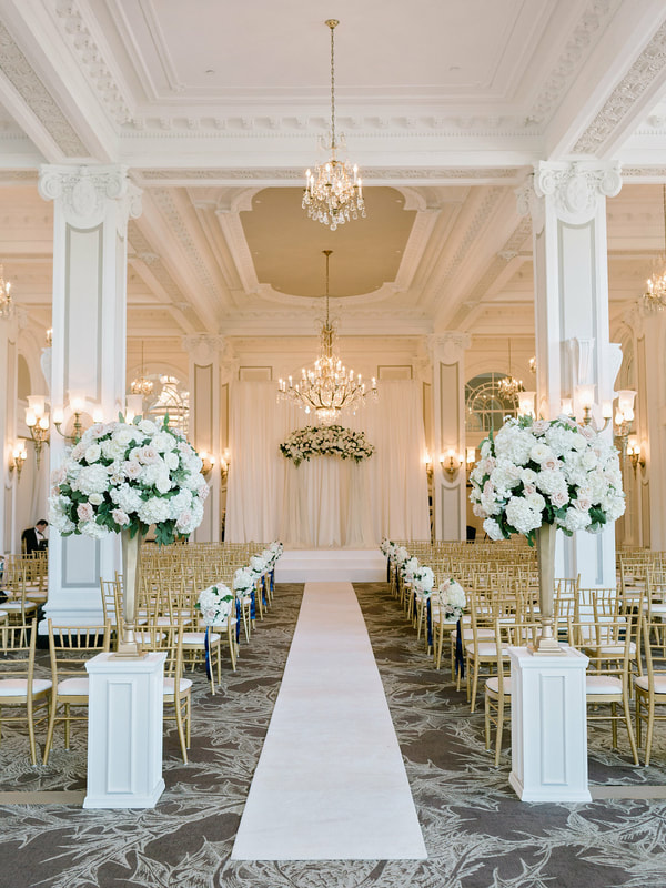 classic elegant white wedding ceremony in banquet hall