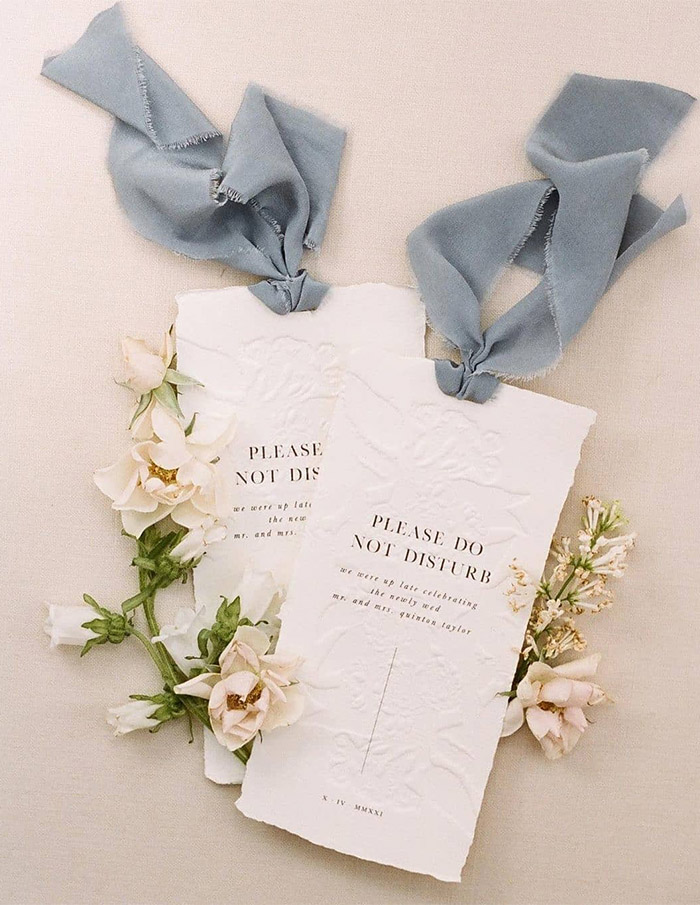 creative and chic letterpress wedding stationery with long ribbon tie on the top
