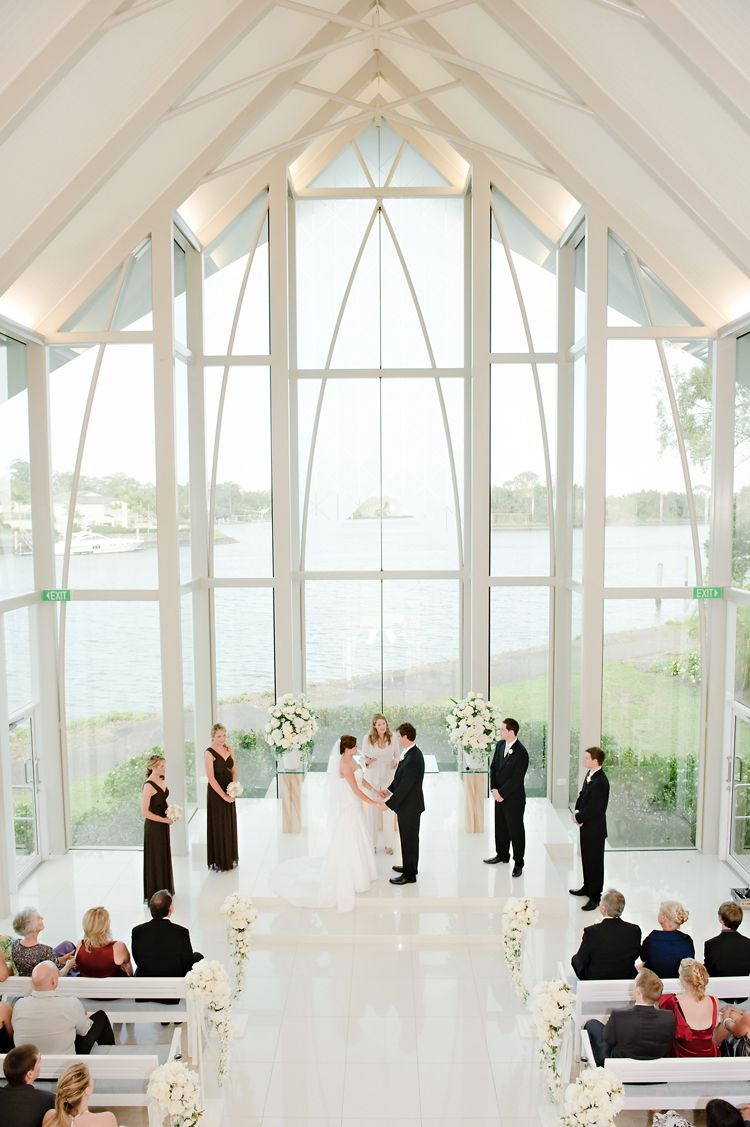elegant and formal open air waterfront chapel wedding ceremony