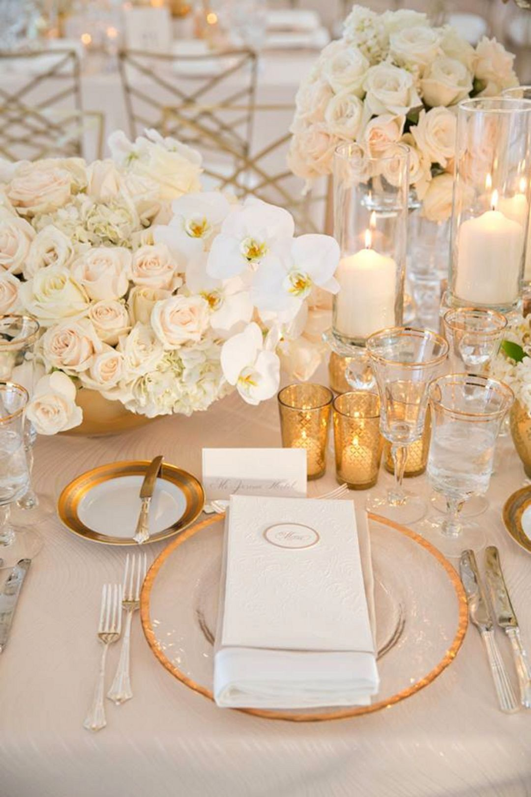 formal glamorous white flower and glitter wedding table settings
