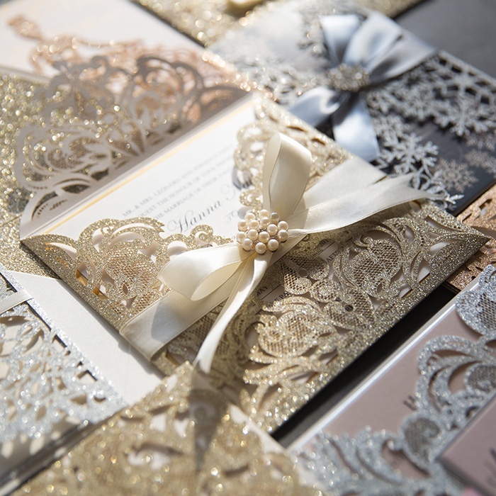 luxury and elegant champagne gold laser cut wedding invitation with ribbons
