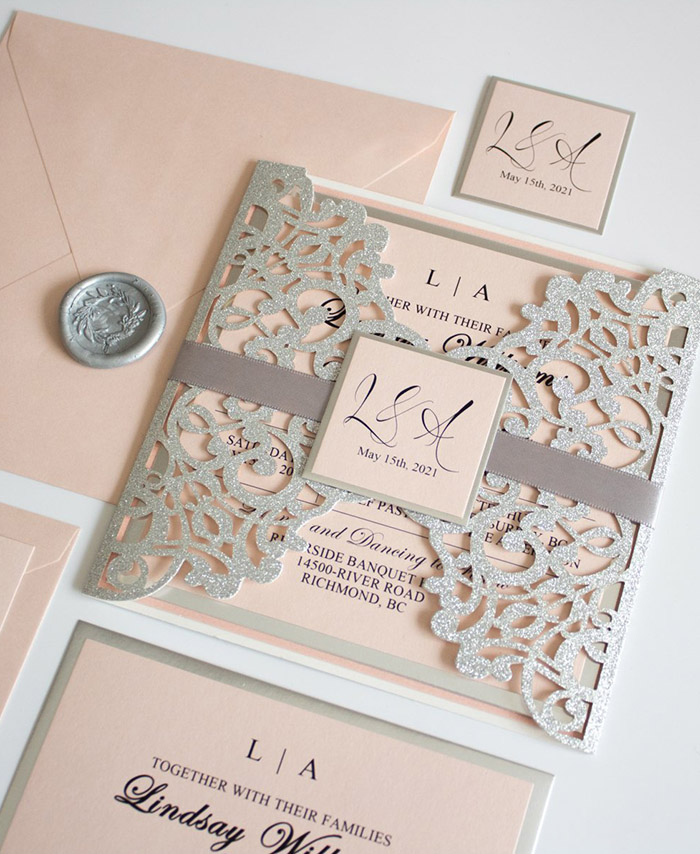 silver and blush pink glitter wedding invitation with tags