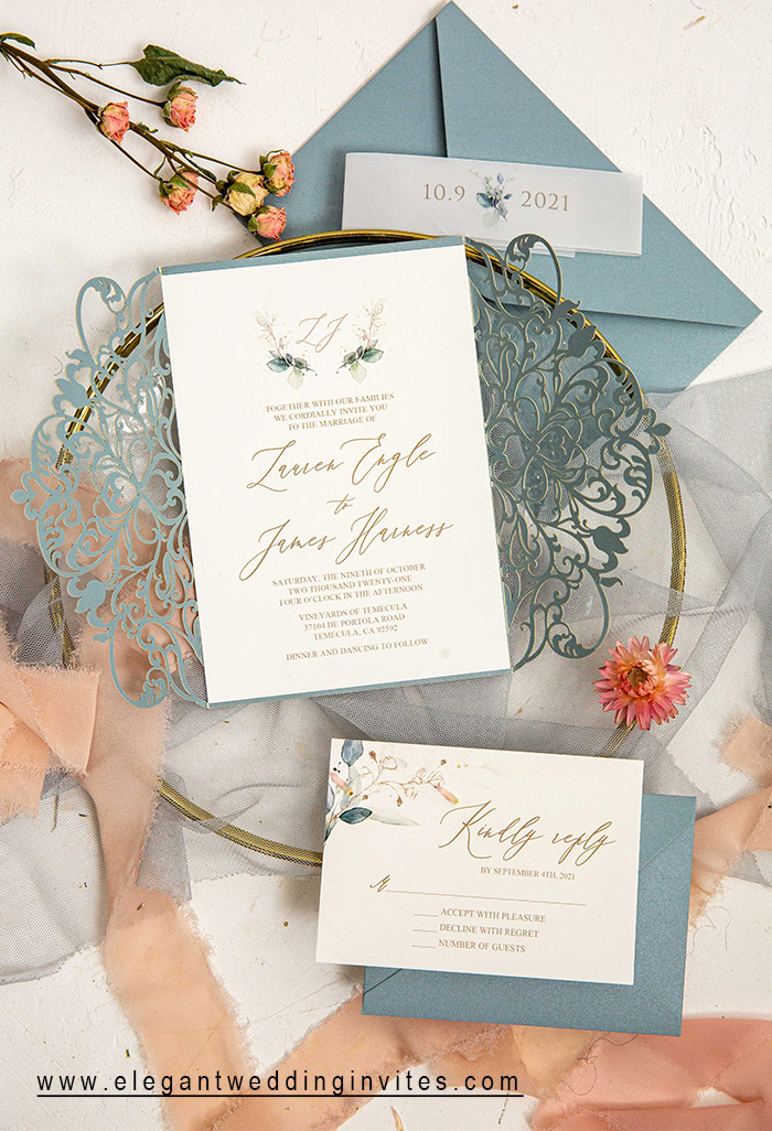 simple but elegant laser cut wedding invitation with vellum belly band